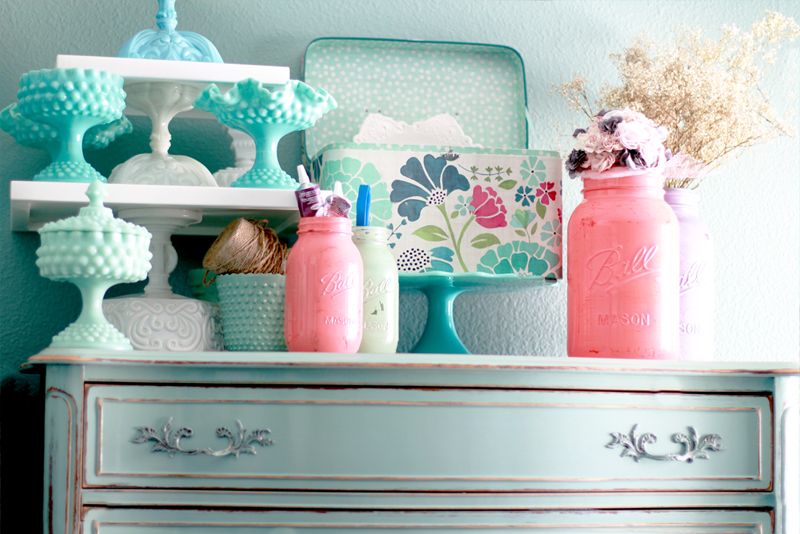 Dessert Table Centerpieces with vintage milk glasses on distressed robin egg blue dresser