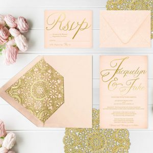 blush and gold wedding invitations with gold doily liners