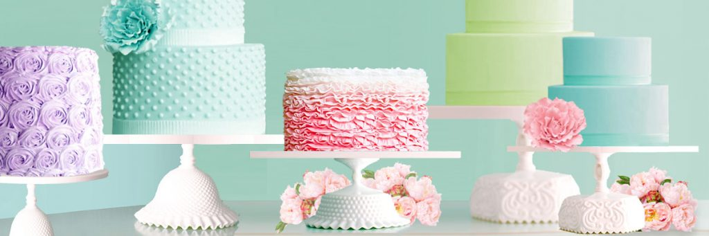 a dessert table with handcrafted cake stands