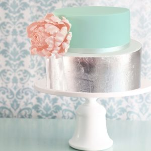 Simple bell-shaped cake stand with silver and mint green cake