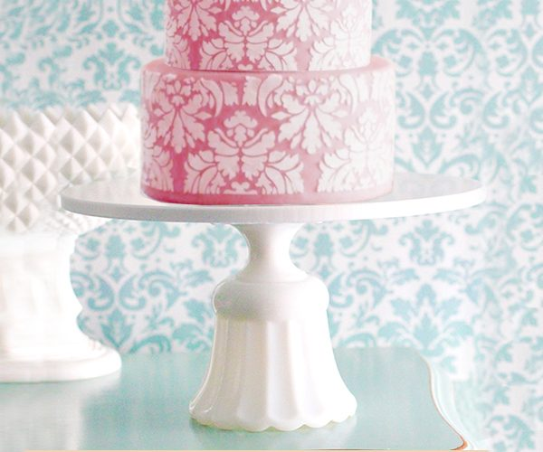 Scallop cake stand with pink damask wedding cake
