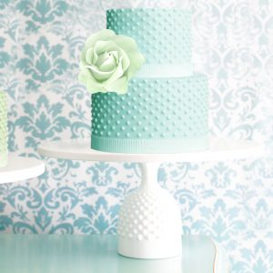 Hobnail cake stand with mint dotted wedding cake