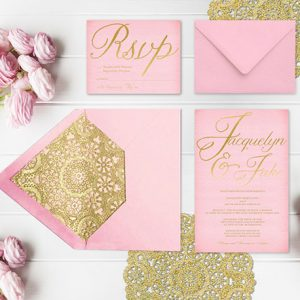 pink and gold wedding invitations with gold doily liners