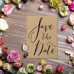 Calligraphy on kraft save the date cards