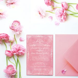 Vintage-inspired filigree coral pink wedding invitations
