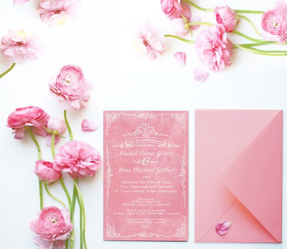 Vintage-inspired filigree coral pink wedding invitations