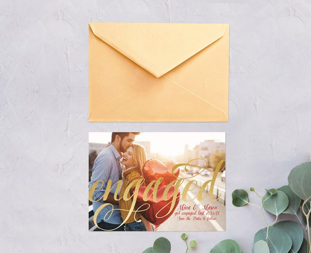 Metallic gold foil calligraphy engagement party invitations