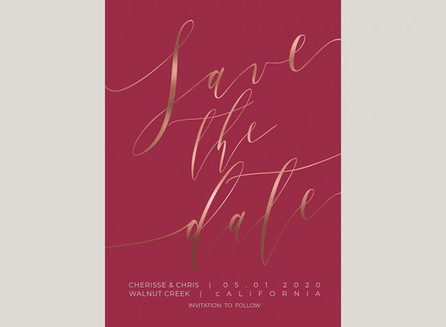 Rose gold calligraphy on ruby red save the date cards