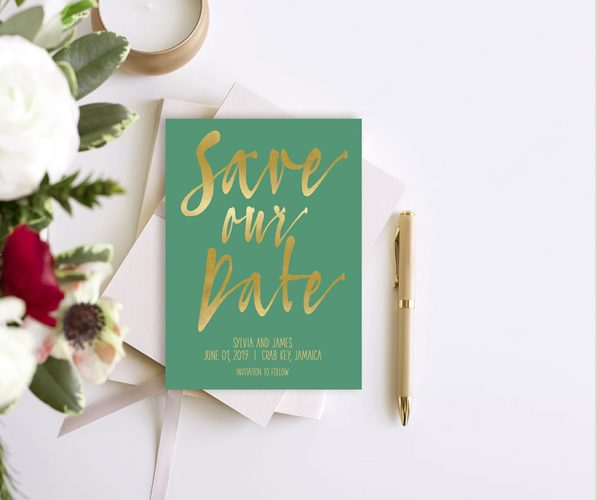 Gold calligraphy on emerald green save the date cards