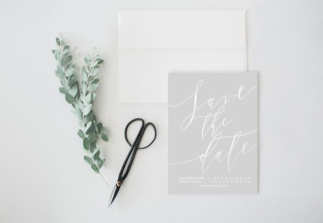 Rose gold calligraphy on dove grey save the date cards