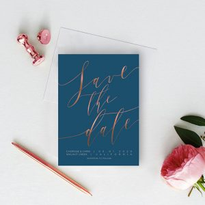 Rose gold calligraphy on navy blue save the date cards