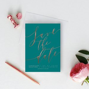 Rose gold calligraphy on peacock blue save the date cards