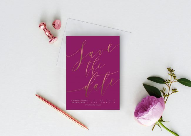 Rose gold calligraphy on purple save the date cards