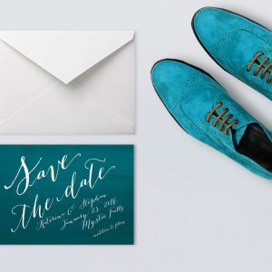 Calligraphy on peacock blue ombre save the date cards