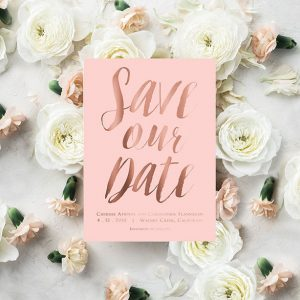 Rose gold calligraphy on rose quartz save the date cards